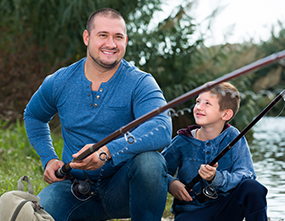 Father and son covered by CareFirst family plan fishing