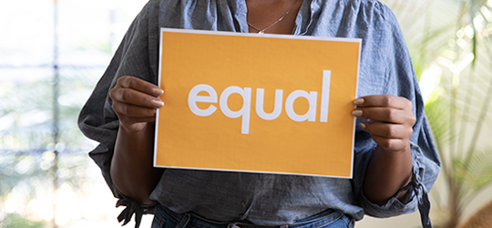 A person holding the equality sign