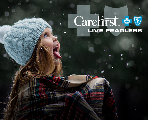 Little girl catching snowflakes
