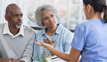 Two seniors discussing privacy information with primary care provider